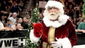 Mick Foley wearing Santa suit costume